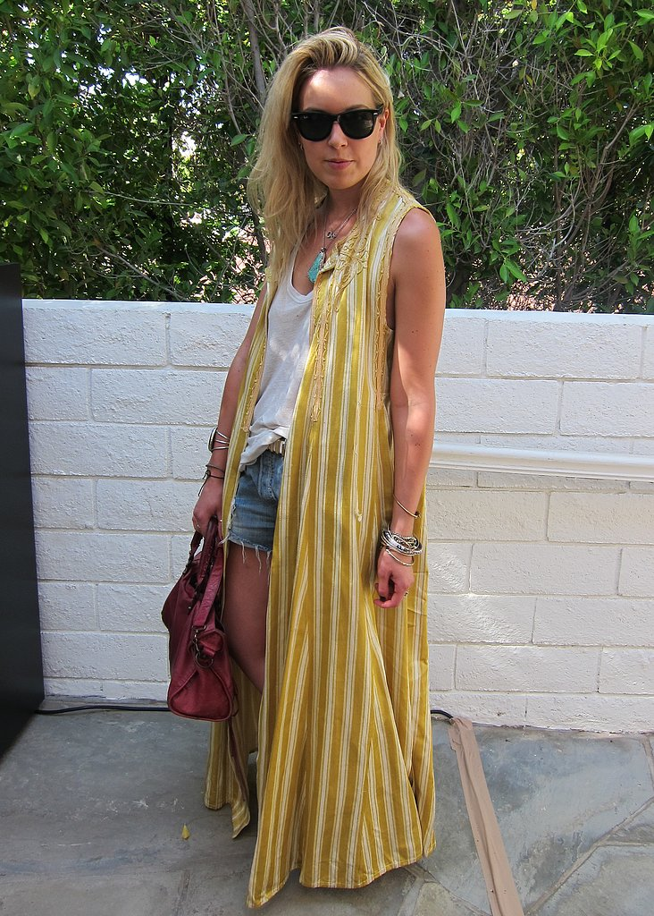 Behold bohemian glamour in the way of a vintage striped, sleeveless topper and a Balenciaga bag. Source: Chi Diem Chau