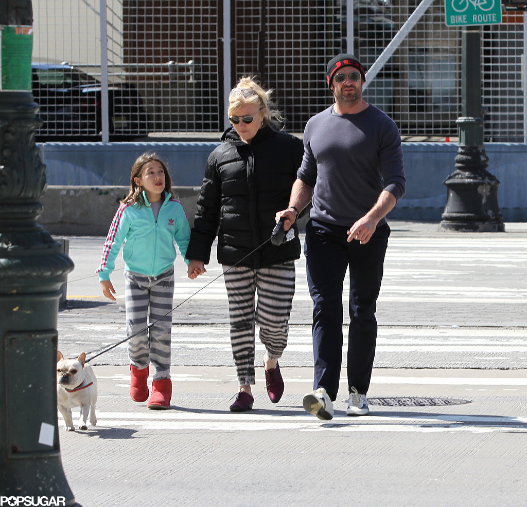 Hugh Jackman and his wife Deborra-Lee Furness took their daughter Ava out to walk their dog Peaches in NYC on Sunday.