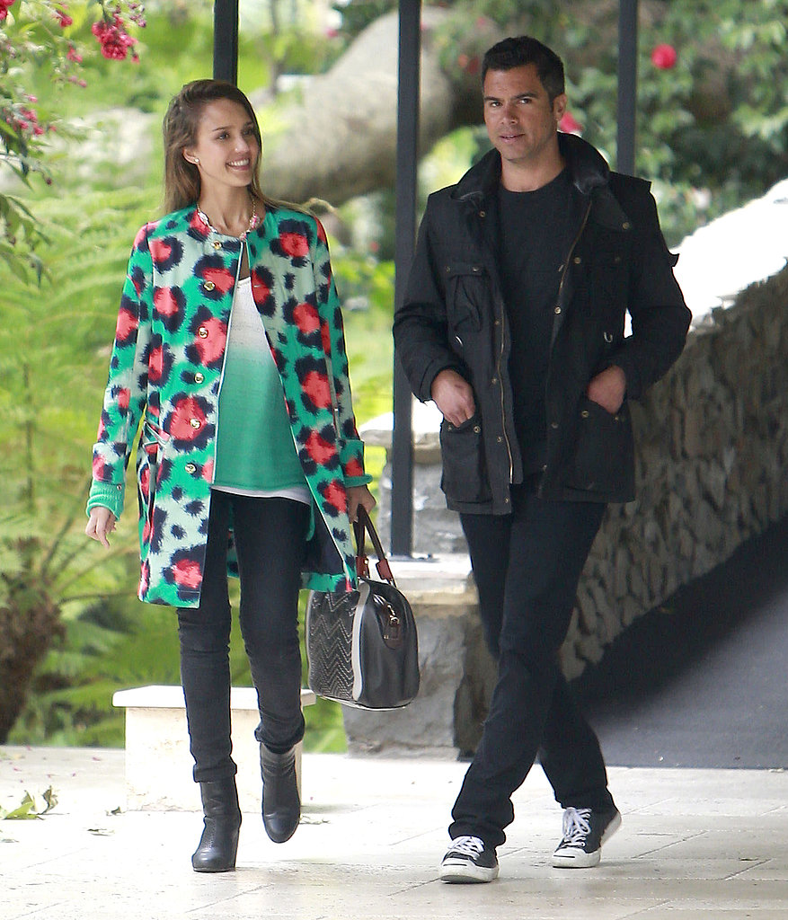 Jessica Alba made herself stand out in a colorful animal-print Kenzo coat, a matching green tank, and a Missoni bag at Jessica Simpson's baby shower in Beverly Hills.