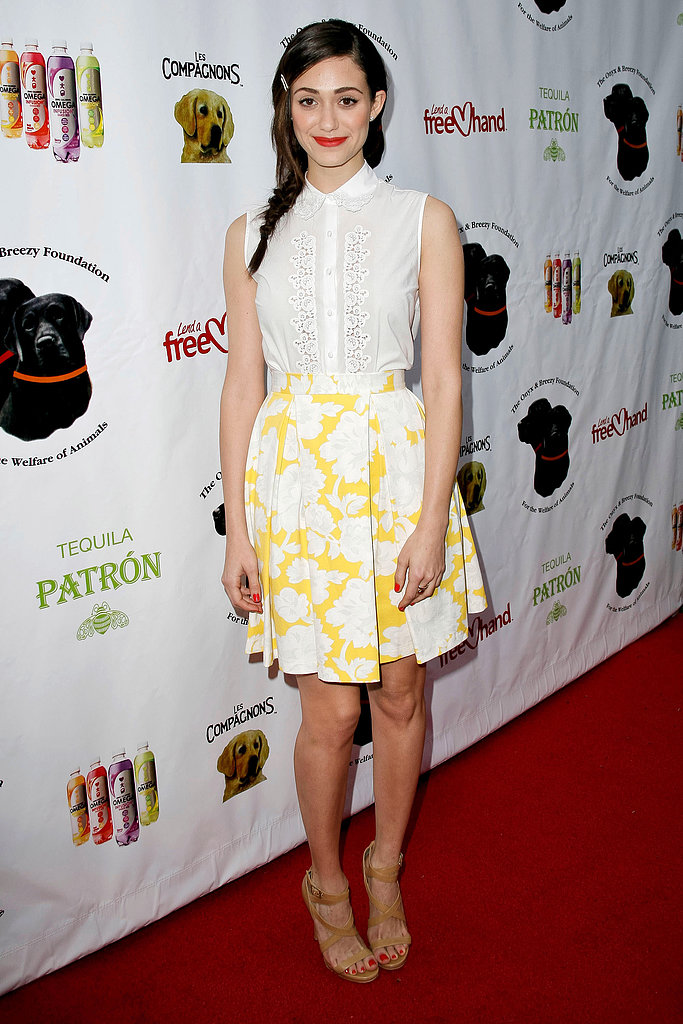 Emmy Rossum showed how to work Topshop separates with feminine flair. She tucked a sleeveless white blouse with lace detail into a pleated yellow-and-white skirt, then added tan strappy sandals and a sassy red lip to finish.