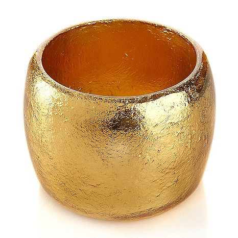 Iris Apfel Gold Wide Bangle Bracelet Give even a white button-down and jeans the Midas touch with this slip-on, cuff-style resin bangle in a gold-colored foil design.