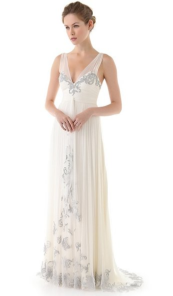 This Catherine Deane metallic appliqué gown ($1,890) definitely stands out from a sea of strapless wedding gowns. The beading really gives it that one-of-a-kind feel.