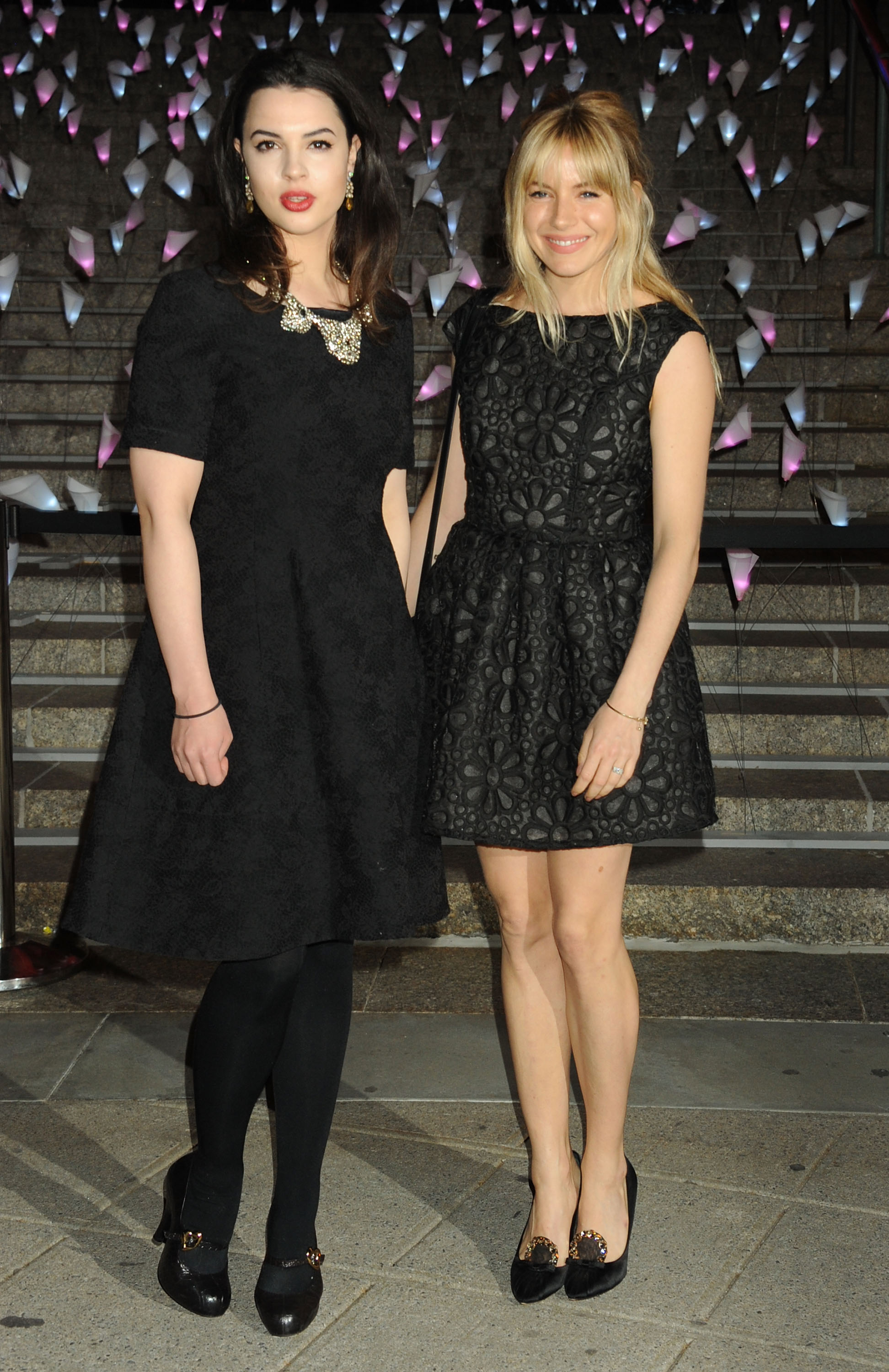 Sienna Miller held hands with Tom Sturridge's sister, Matilda Sturridge, at the Vanity Fair bash.