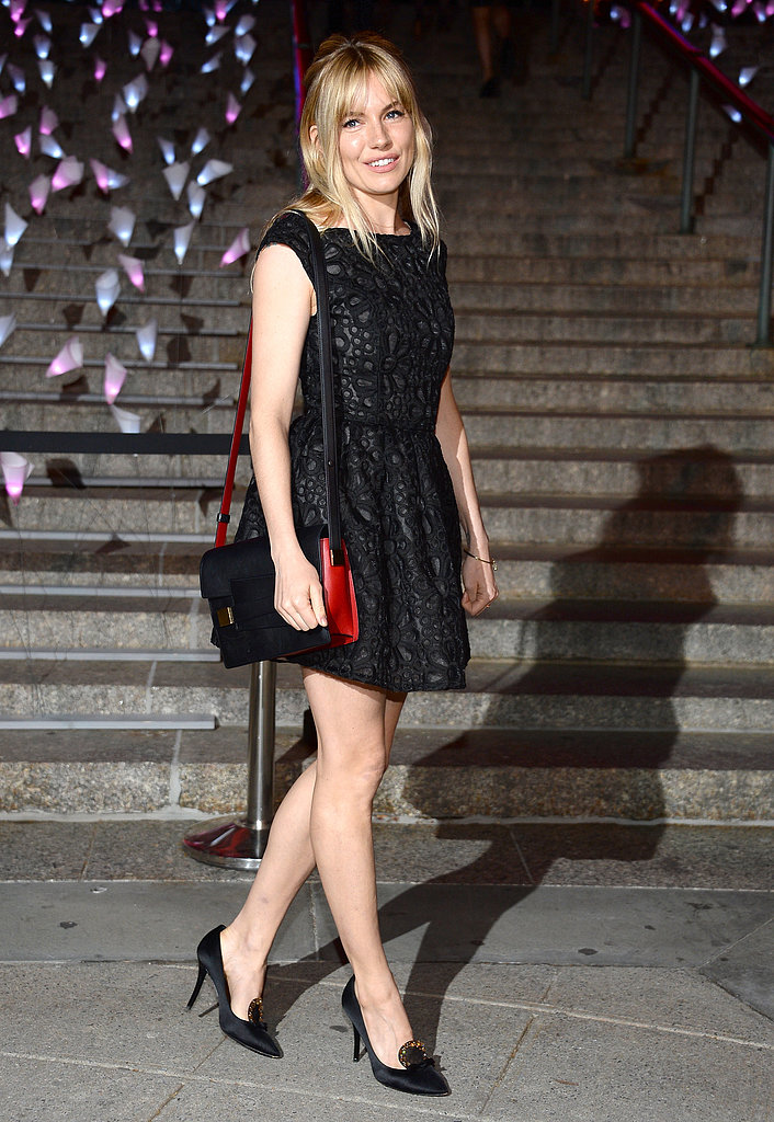 Sienna Miller stepped out at Vanity Fair's Tribeca Film Festival party in a floral-eyelet-detailed LBD by Topshop, bejeweled black heels, and a cool red and black Madame satchel by Delvaux.