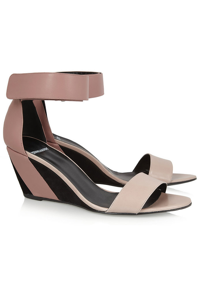 We love the cool colorblocking details on Pierre Hardy's leather and suede wedge sandals ($775).