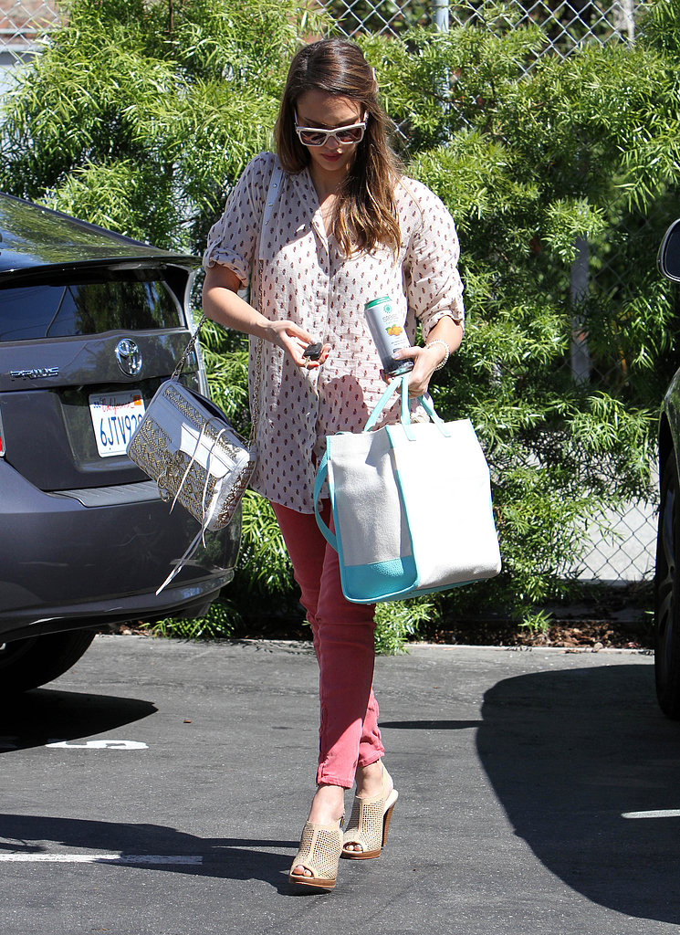 While out and about in LA, Jessica donned a printed button-down with red denim, perforated mules, and a sparkling Rebecca Minkoff crossbody bag.