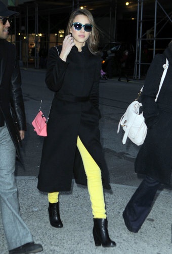 Style so bright, she has to wear shades. While out and about in New York, Jessica paired her black separates with daffodil yellow denim and a pink Loewe bag.