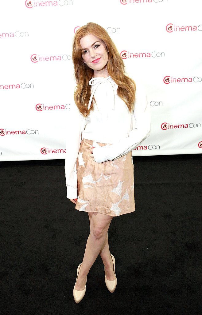Isla Fisher matched a white blouse with a printed skirt, then added a pair of Casadei nude platform pumps for height.