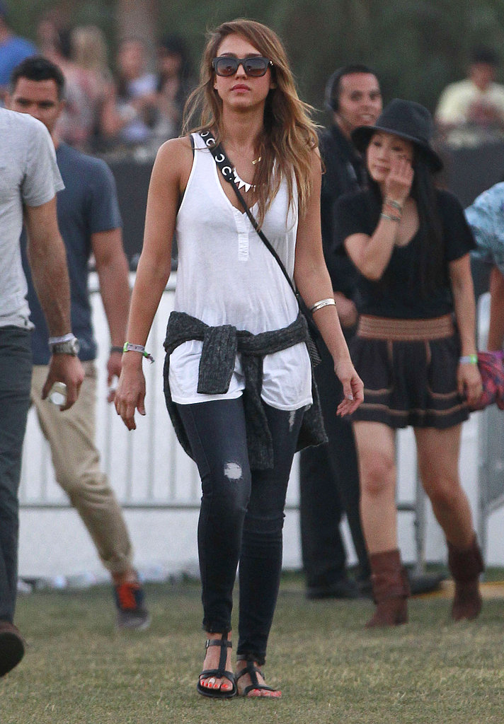 Jessica Alba slipped into distressed denim by 7 For All Mankind, a breezy white tank, an Inhabit sweater, Matt Bernson sandals, and cool-girl jewels for the second day at Coachella's second