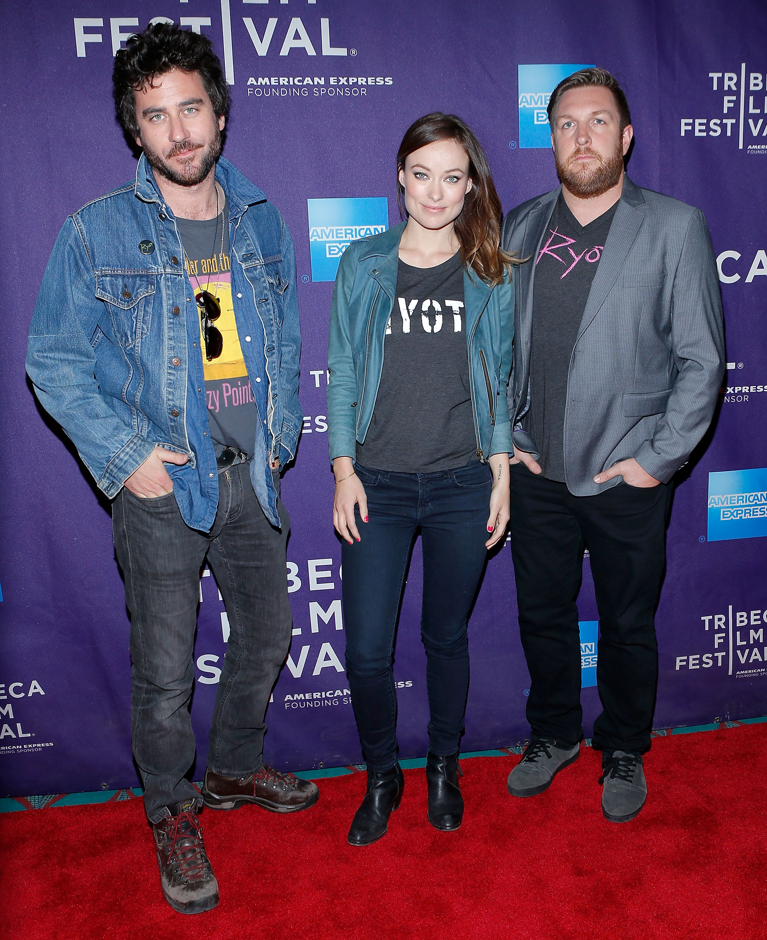 Olivia Wilde posed with Bryn Mooser and David Darg on the red carpe