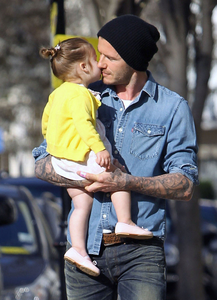 Harper Beckham gave her dad, David Beckham, a kiss on the cheek during a London stroll in April.