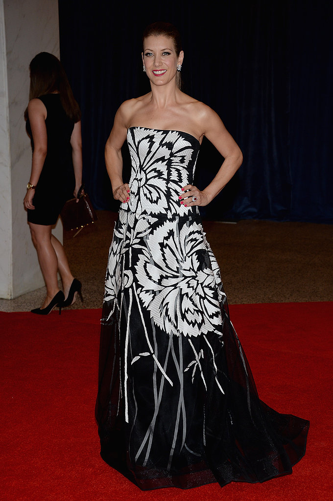 Kate Walsh showed off a bold black-and-white printed Carolina Herrera gown, but kept the rest of her look understated. Her hair was swept back to reveal a pair of glittering earrings.