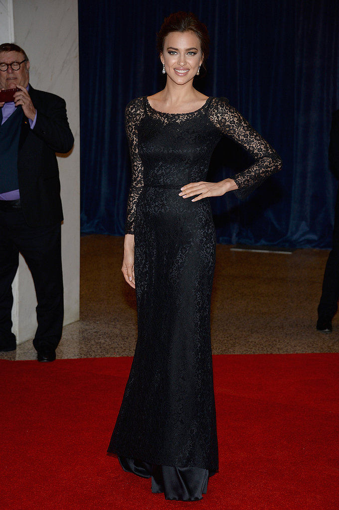 Irina Shayk arrived in a long-sleeved black lace gown, accessorized with delicate drop earrings.