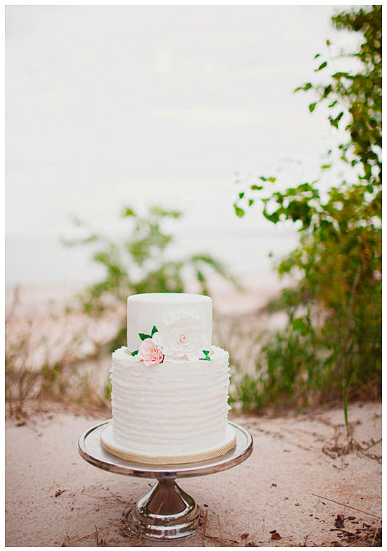 This two-layered ruffle and floral cake is effortless and elegant all at once; consider it a great option for beach weddings and beyond.  Photo by Sarah Layne Photography via 100 Layer Cake