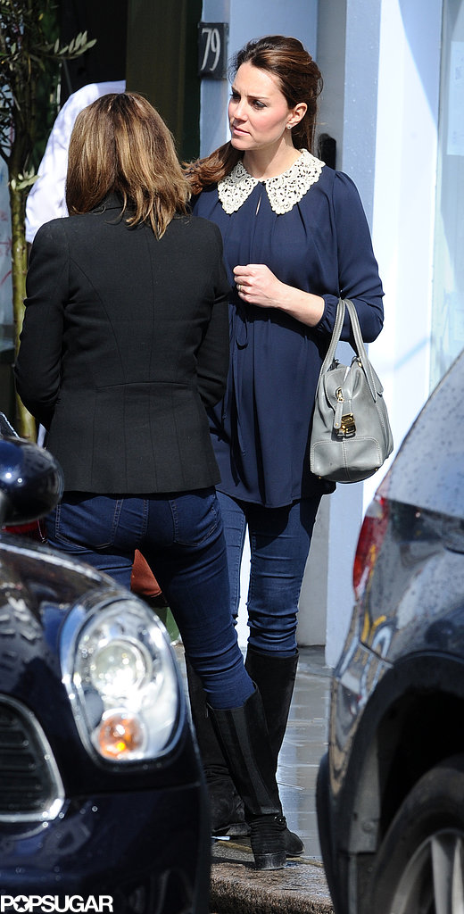Kate Middleton wore a navy blouse shopping.