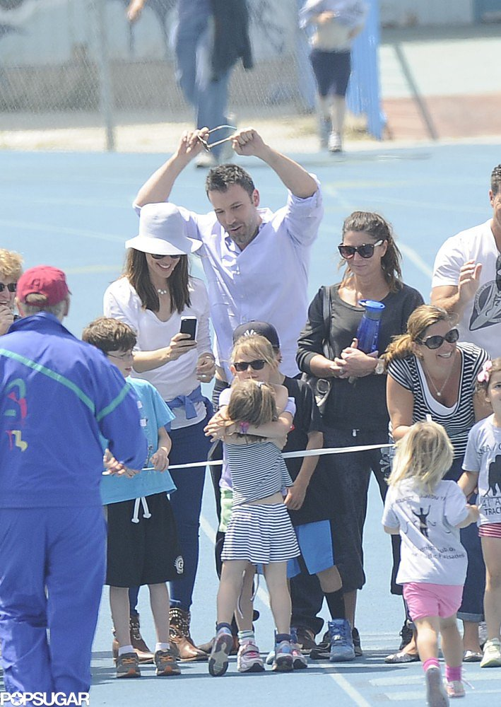 Ben Affleck, Jennifer Garner, and Violet Affleck cheered on Seraphina as she crossed the finish line at her track meet in Pacific Palisades, CA.