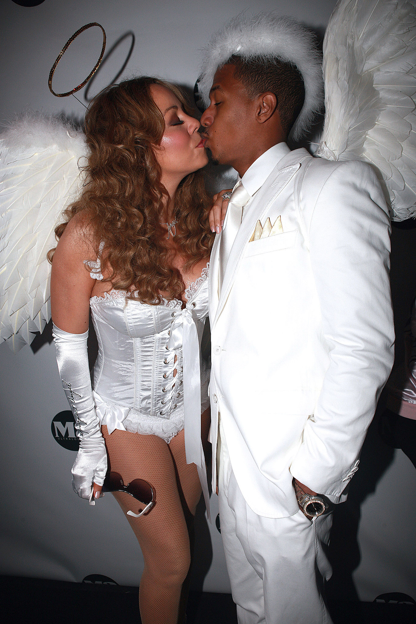 Mariah Carey and Nick Cannon shared an angelic kiss during an NYC Halloween party back in October 2009.