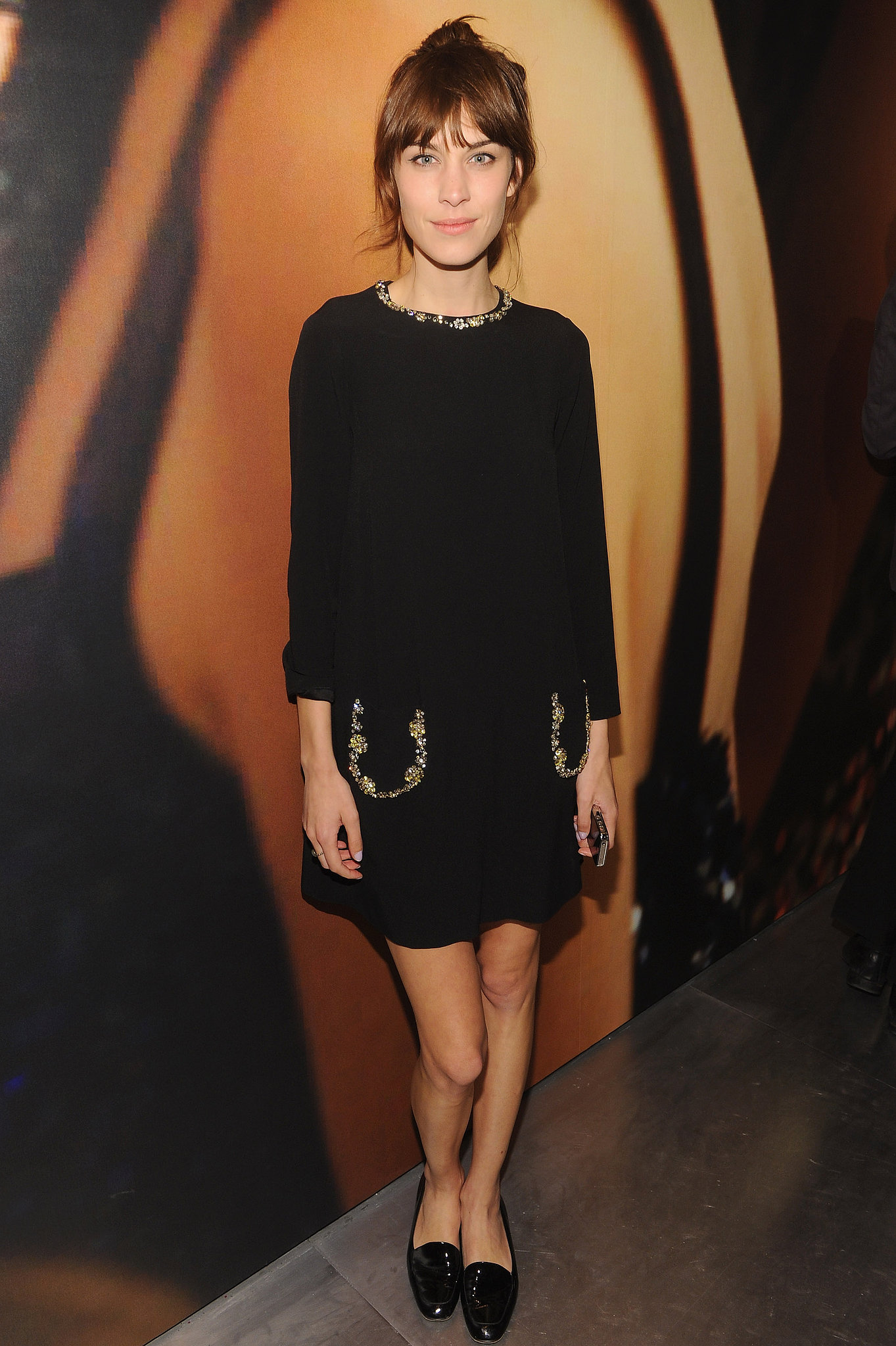 Alexa Chung opted for a more casual ensemble wearing a Miu ...