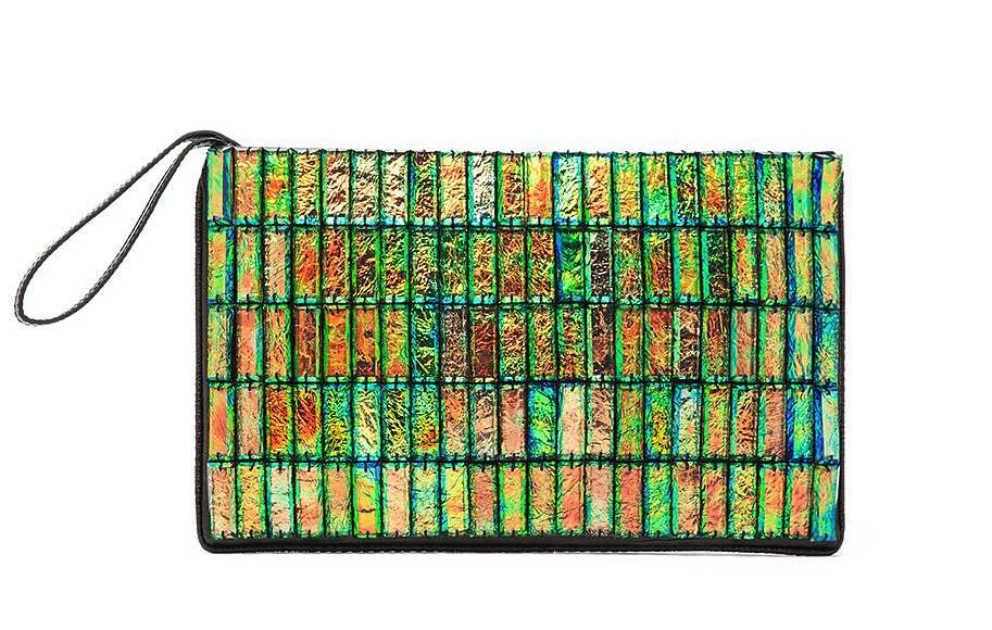 How can you deny this eye-catching Stella McCartney faux alligator clutch ($1,515)? Its holographic finish and patchwork-like appearance makes it feel really special — and it guarantees that any outfit will be a little bit less boring. — Marisa Tom