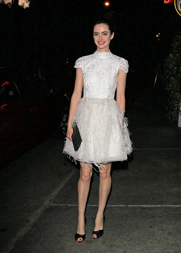 Krysten Ritter's white Alice + Olivia dress offered no shortage of fancy details — check out that feathered skirt! — during an evening out in LA.