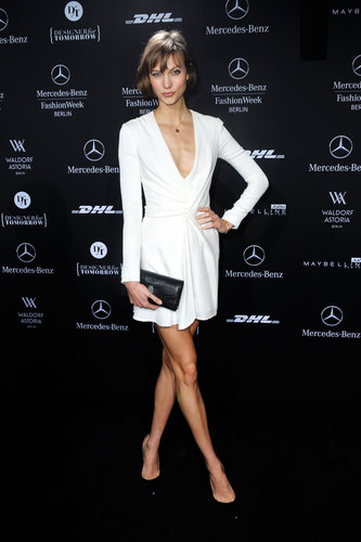 Karlie Kloss kept her sleeves long but her neckline plunging in a white minidress at an event in Berlin. Her black add-ons served as chic contrast.