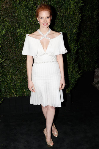 At a pre-Oscar Chanel dinner party in LA, Jessica Chastain fittingly wore a white pleated Chanel dress with an exquisite neckline we can't stop staring at.