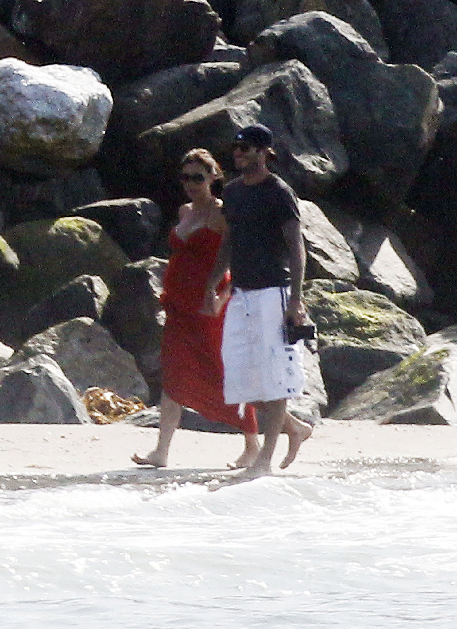 They walked arm in arm on the beach in Malibu in July 2011.