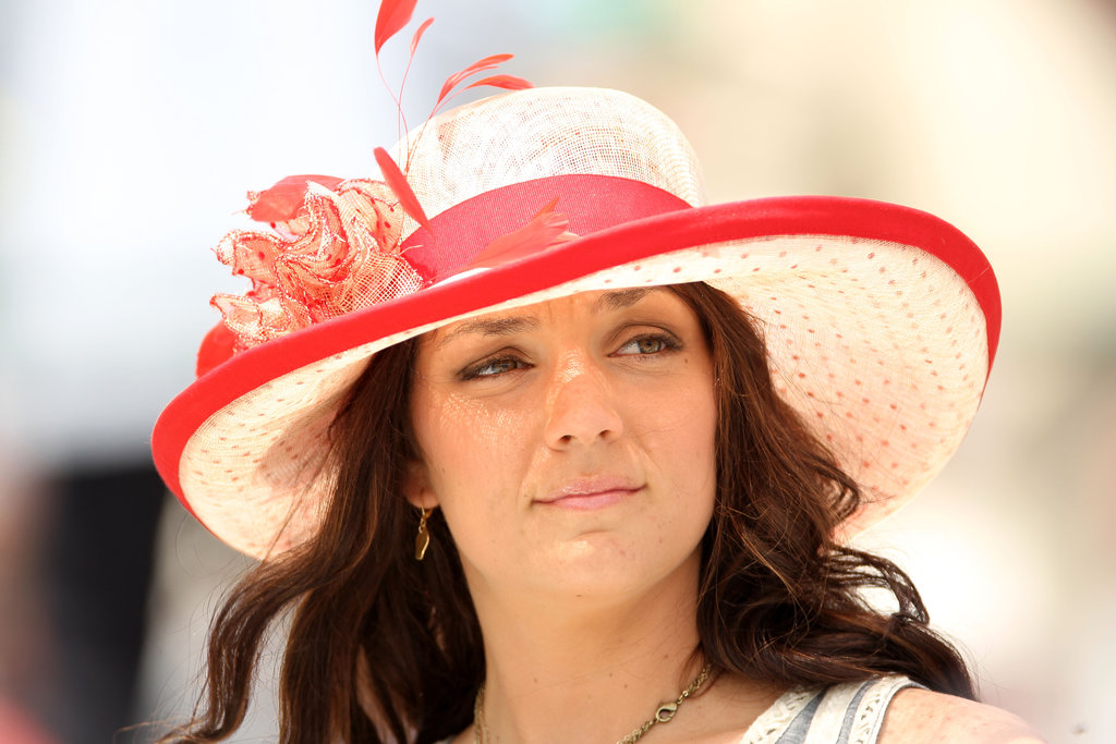 At the 2012 race, a woman wore a pretty cream and red polka-dot hat.