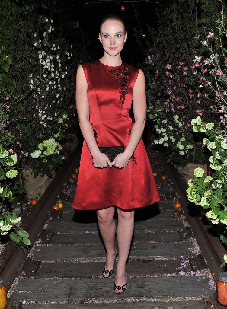 Joanna Vanderham, who costars in the film, wore a red dress.