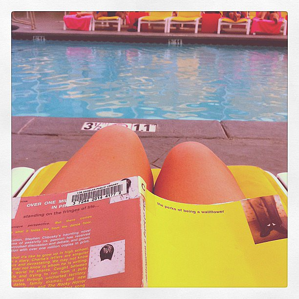 "Marsxxxx read by the pool, stating, ""Perfect afternoon."""