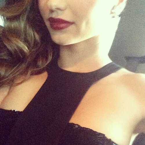 Miranda Kerr teased her red lips and black Michael Kors dress. Source: Instagram user mirandakerr