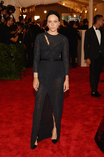Chloë Sevigny matched a black Proenza Schouler cutout gown with a turban-style headband.