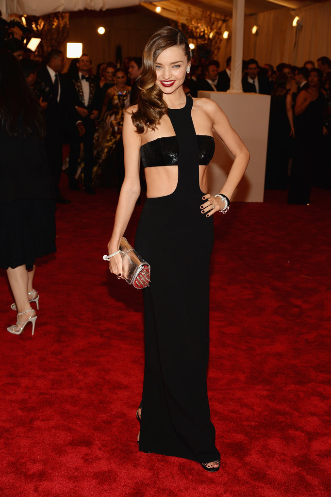 Miranda Kerr stunned in her black cut-out Michael Kors gown.
