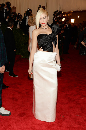 Gwen Stefani's Maison Martin Margiela ensemble — a black satin bow top and a white maxi skirt — was feminine with a punk rock edge. She finished the look with a Ferragamo white clutch and Fred Leighton diamonds.