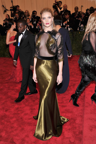 Rosie Huntington-Whiteley exposed just enough skin in her black-and-gold netted Gucci gown. She added a Lorraine Schwartz ring for added shine.