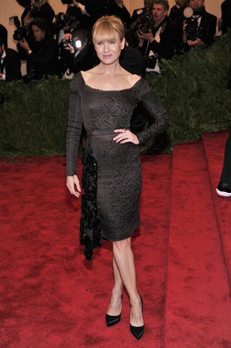 Renée Zellweger opted for a chocolate brown beaded knee-length dress by Prada.