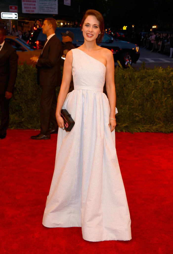Zooey Deschanel was feminine in a one-shouldered seersucker Tommy Hilfiger gown, Forevermark diamonds, Jimmy Choo sandals, and a cheeky safety pin clutch.