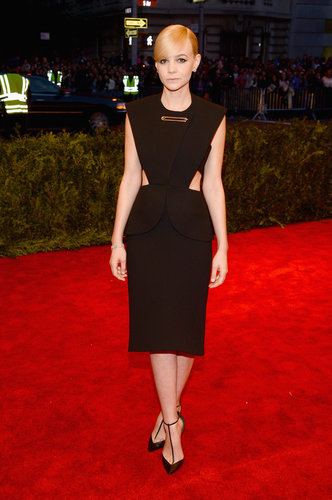 Carey Mulligan gave a nod to the '80s in her black Balenciaga by Alexander Wang cutout dress, complete with an oversize safety pin detail.