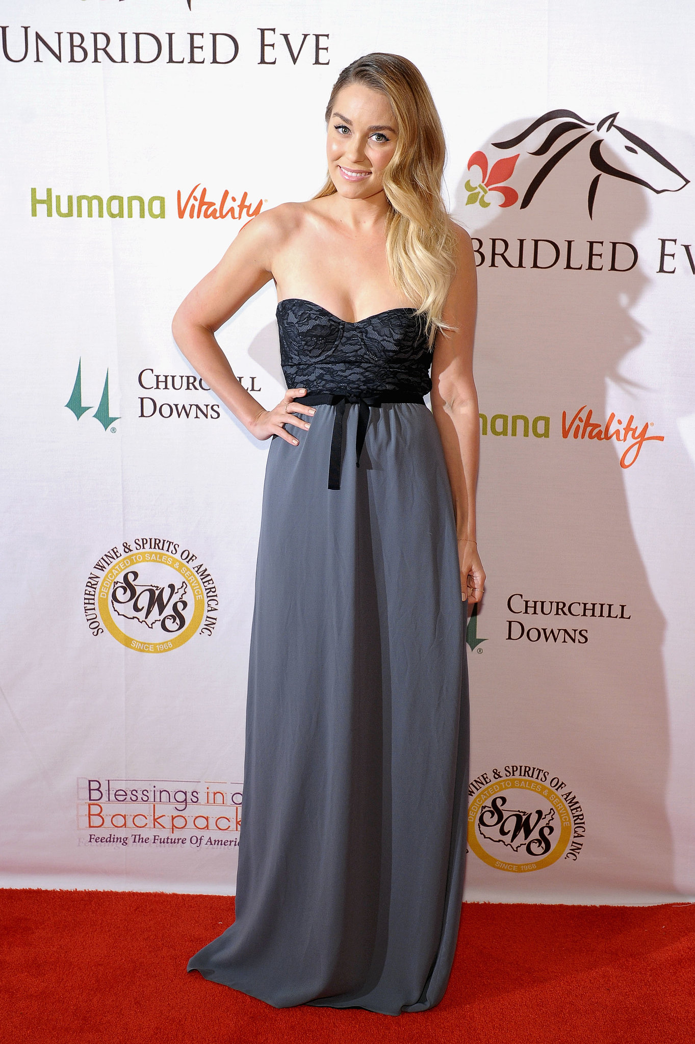 Lauren wore a strapless gown from her own Paper Crown collection on the red carpet at the Unbridled Eve Gala ahead of the Kentucky Derby in May. Lesson from Lauren: bows can be sweet and sophisticated.