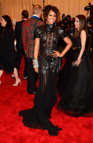 Eve looked tough in heavy eyeliner and a sheer black dress with woven leather strips.