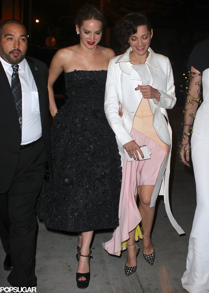 Jennifer Lawrence and Marion Cotillard were arm and arm as they made their way to the Met Gala afterparty.