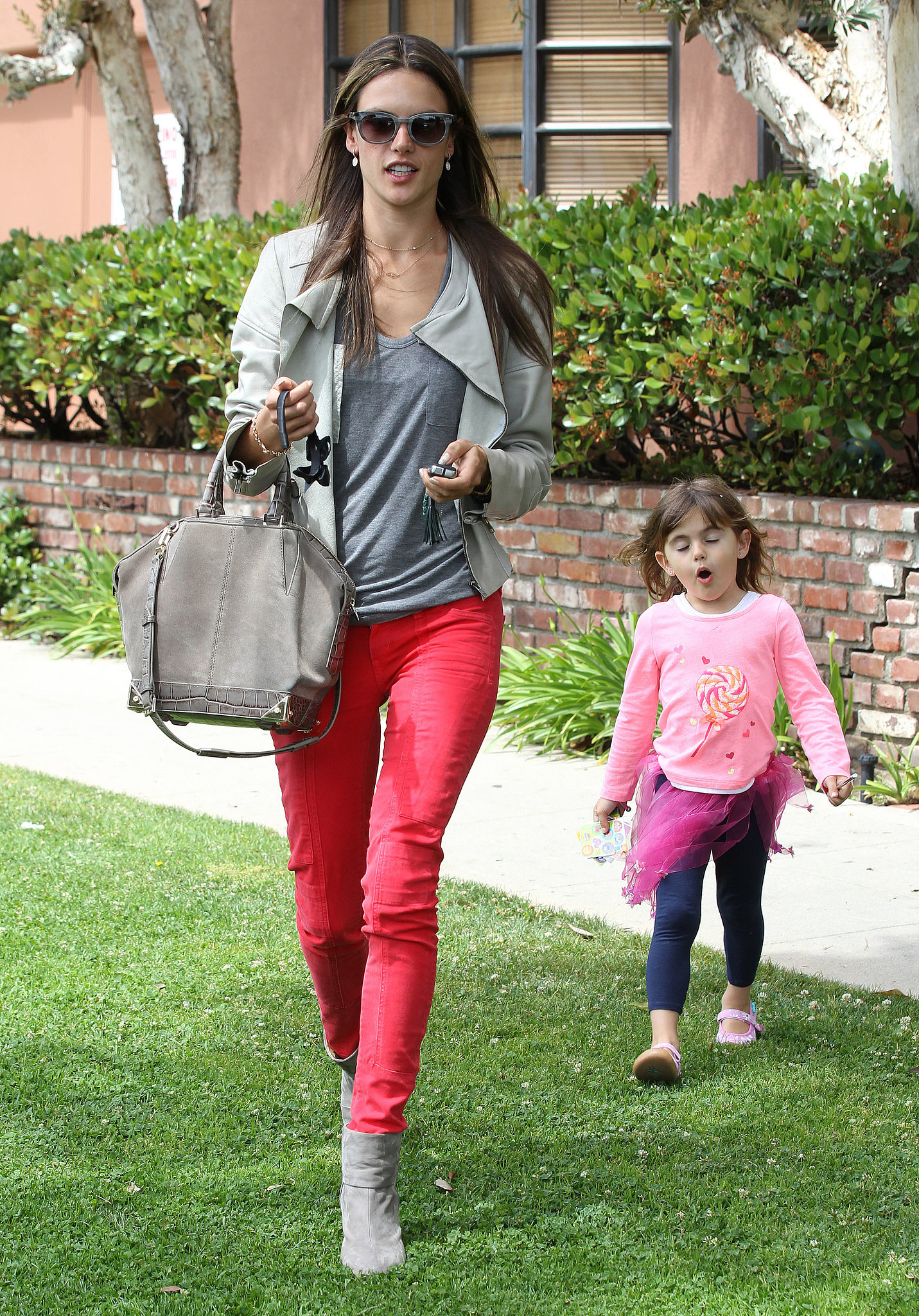 While paying a visit to the doctor, Alessandra Ambrosio kept her top half and Alexander Wang bag neutral but really punched things up o