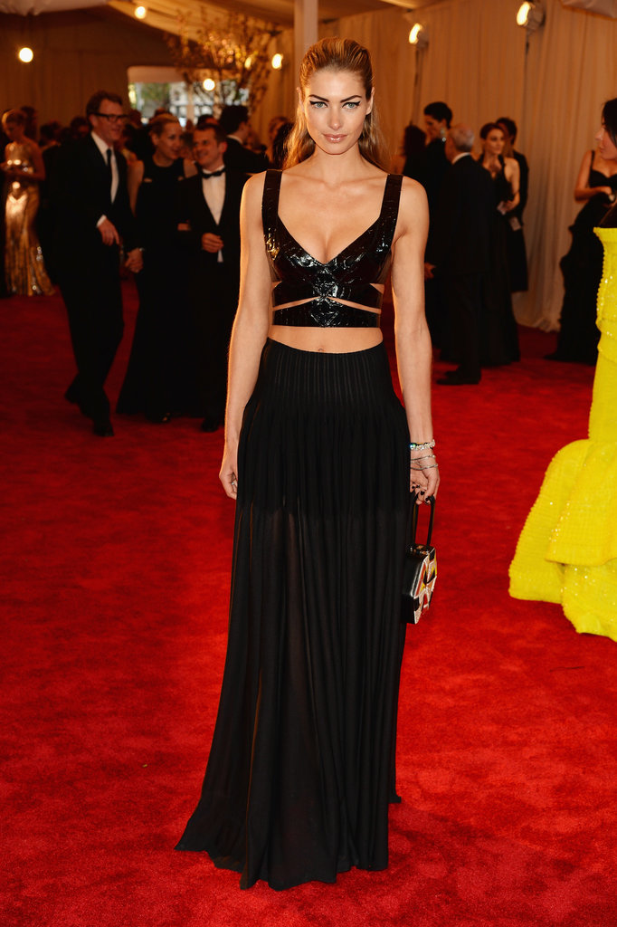 Jessica Hart wasn't afraid to show some skin in a black leather cut-out crop top and a sheer black maxi skirt.