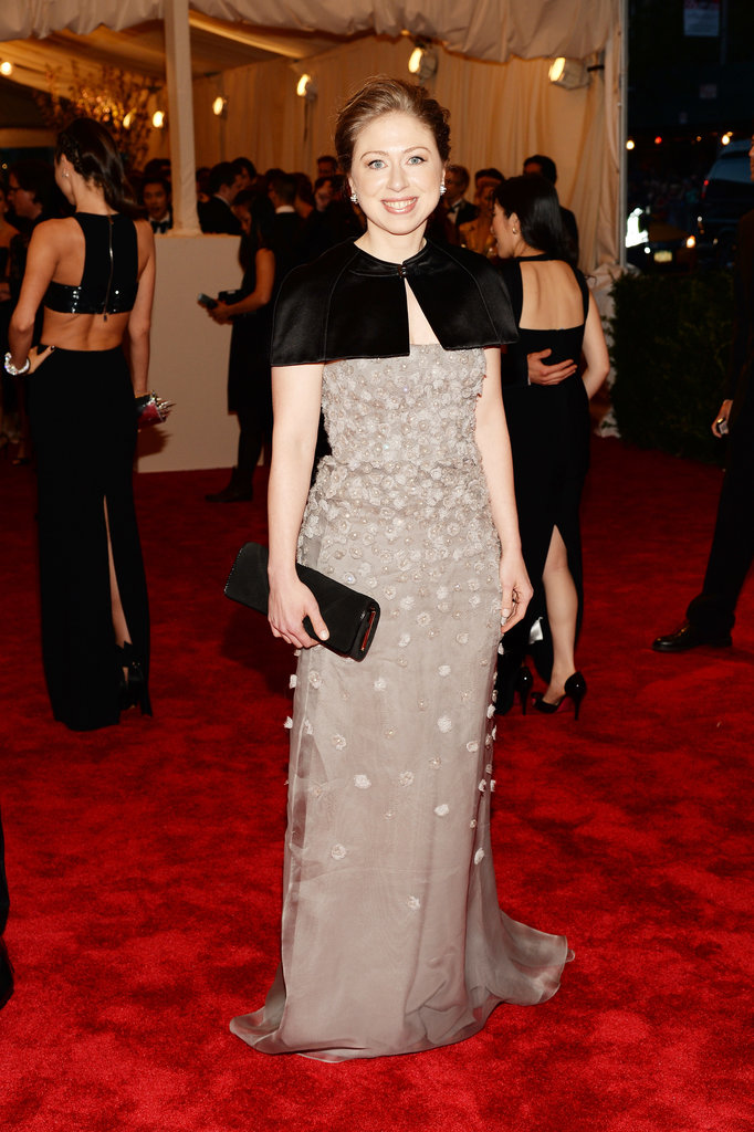 Chelsea Clinton topped off a floral and crystal-embroidered tulle Burberry gown with one of the label's chic capelets. Her black clutch was also by Burberry.