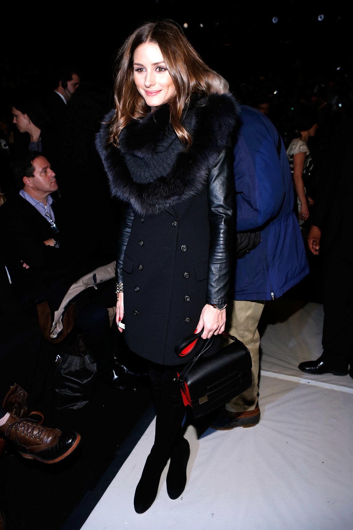 Working a leather-sleeved trench, fur snood, and suede boots at Carolina Herrera's show in NYC, Olivia proved that black on black is anything but boring.