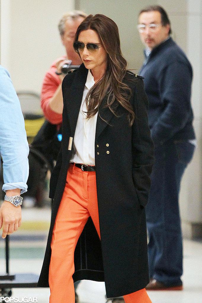 Victoria Beckham strutted her stuff in orange pants.