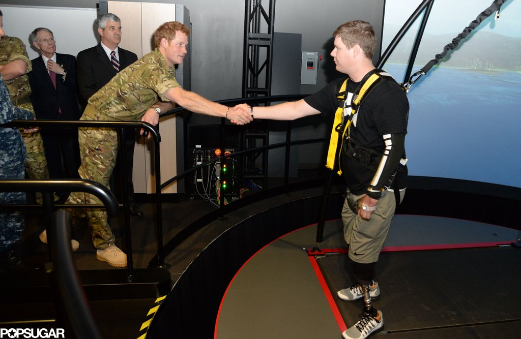 Prince Harry visited with veterans at the Walter Reed Memorial Hospital for injured servicemen in Maryland on Thursday.