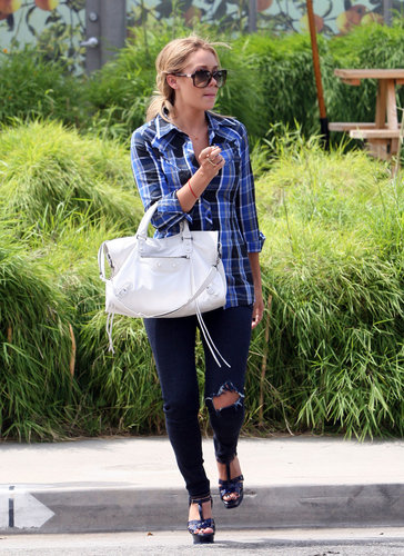 In 2008, LC worked the blue-on-blue trend long before it was popular. Lesson from Lauren: add intrigue to your monochrome looks by mixing various shades.