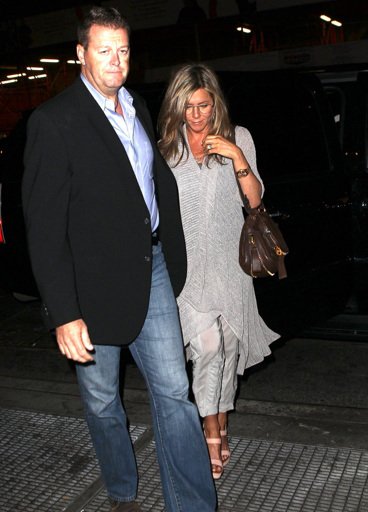 Jennifer Aniston wore a gray outfit.