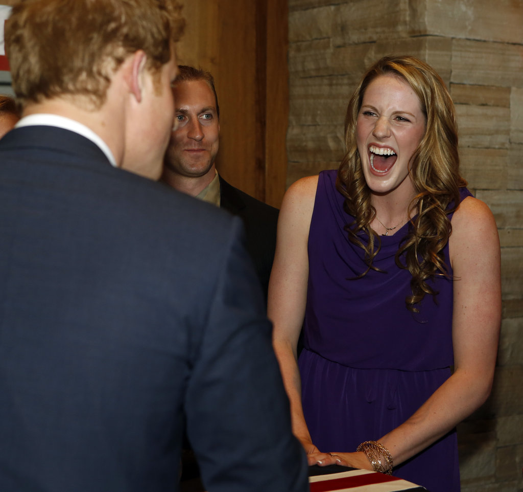 Missy Franklin looked happy to see Prince Harry.